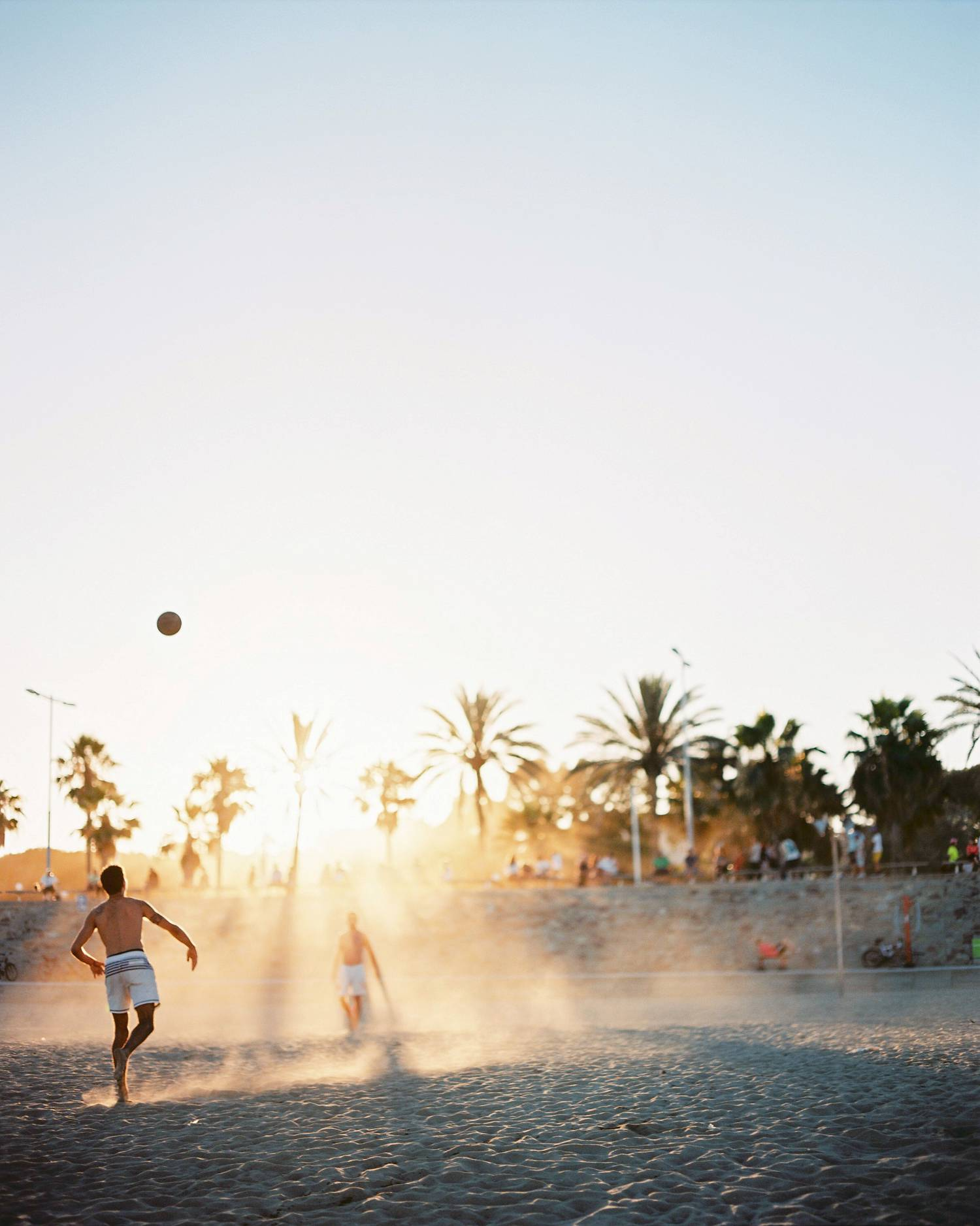 Barcelona film photography people playing ball at the beach at sunset