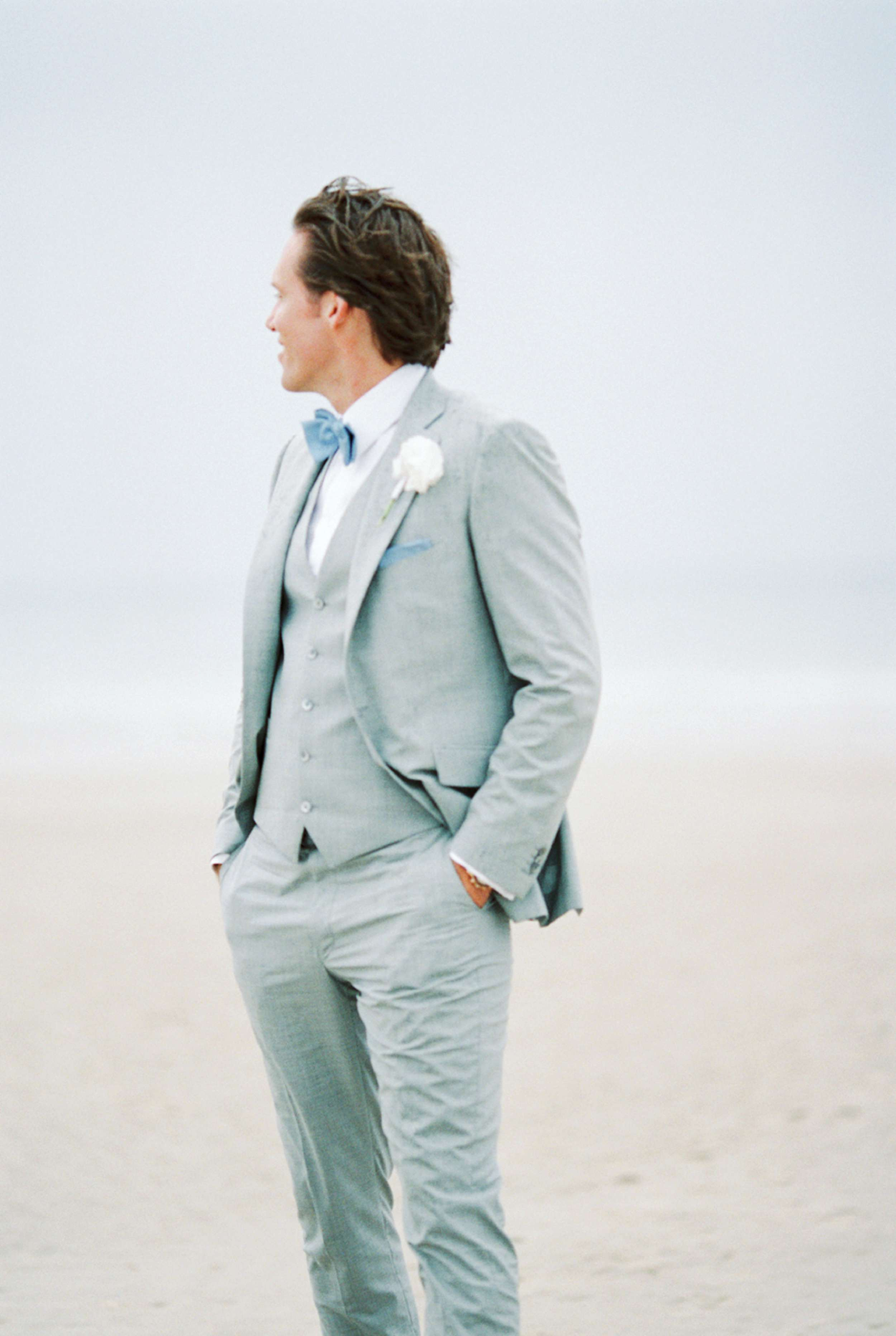 Groom beach wedding North Sea portrait