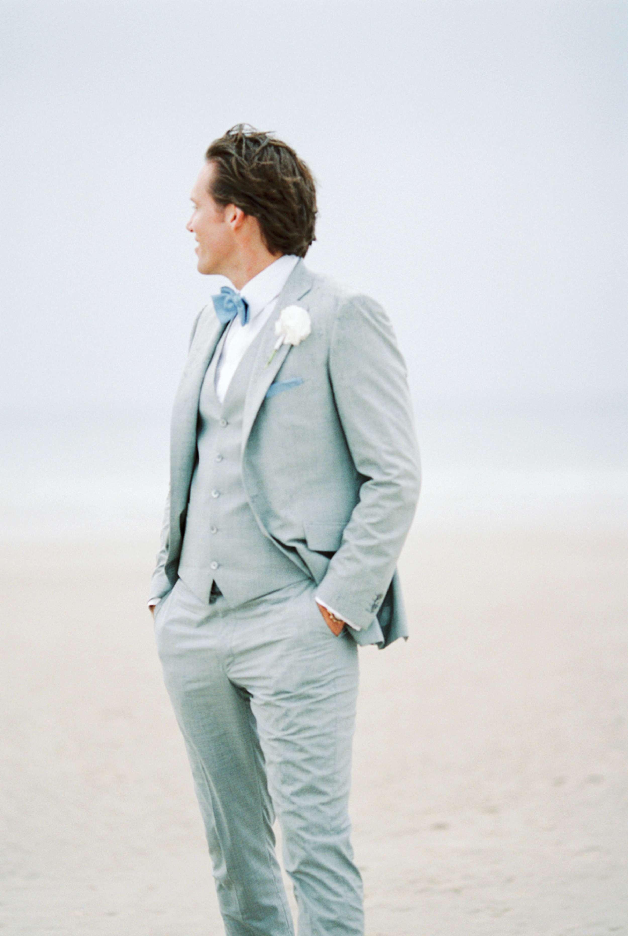 Groom beach wedding North Sea portrait