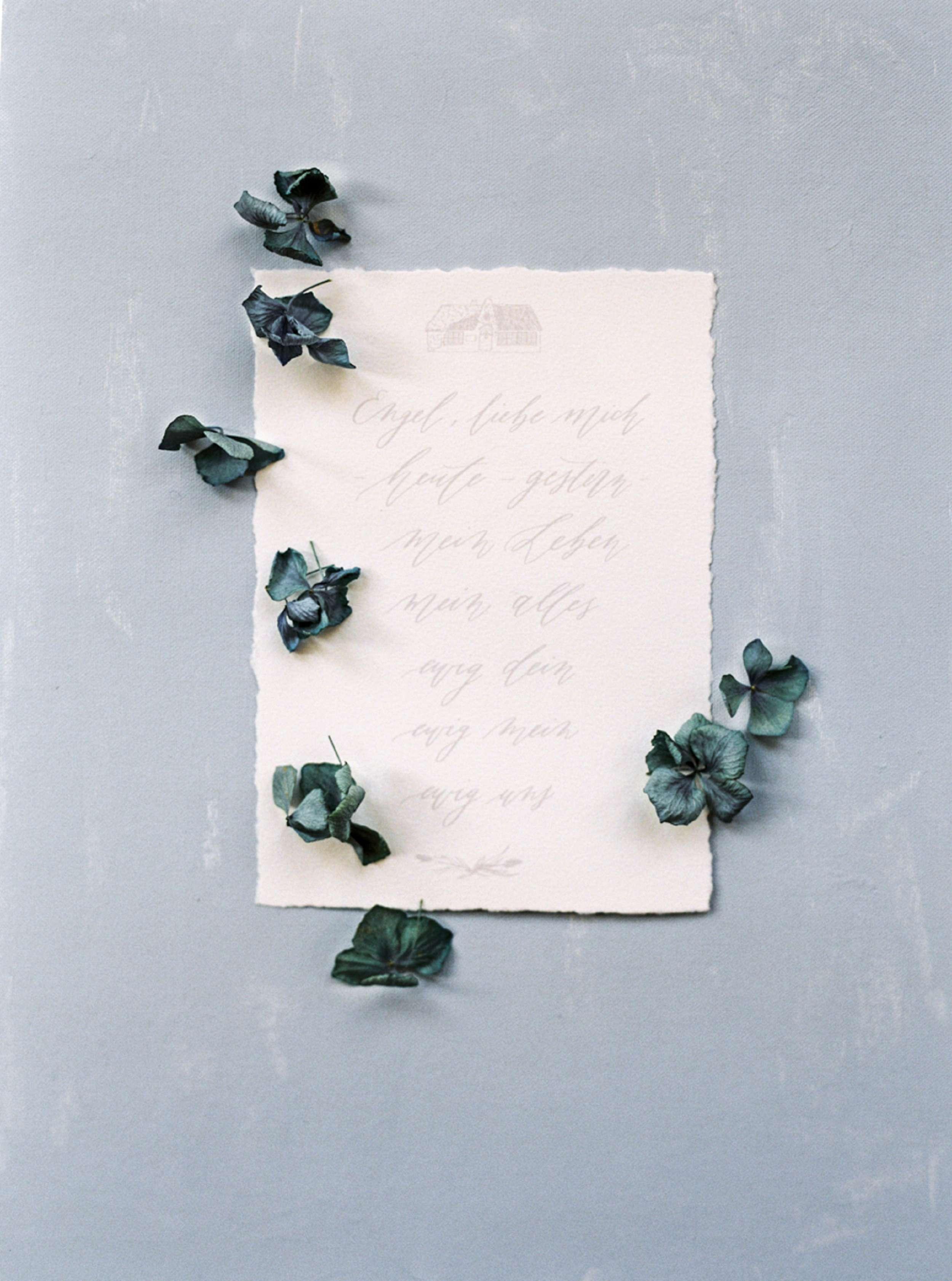 Modern wedding calligraphy in blue tones