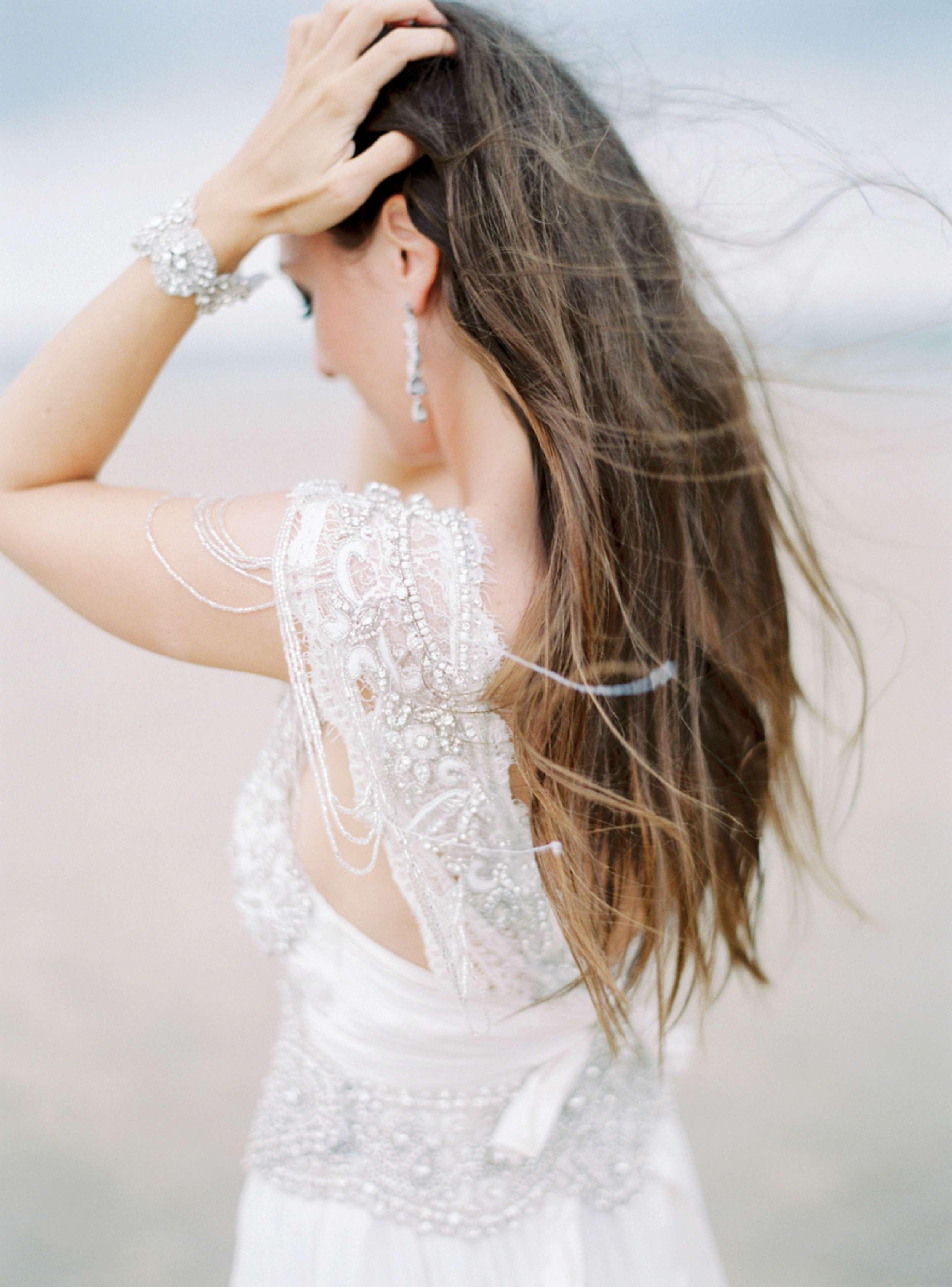 Bride beach wedding North Sea Anna Campbell dress wind