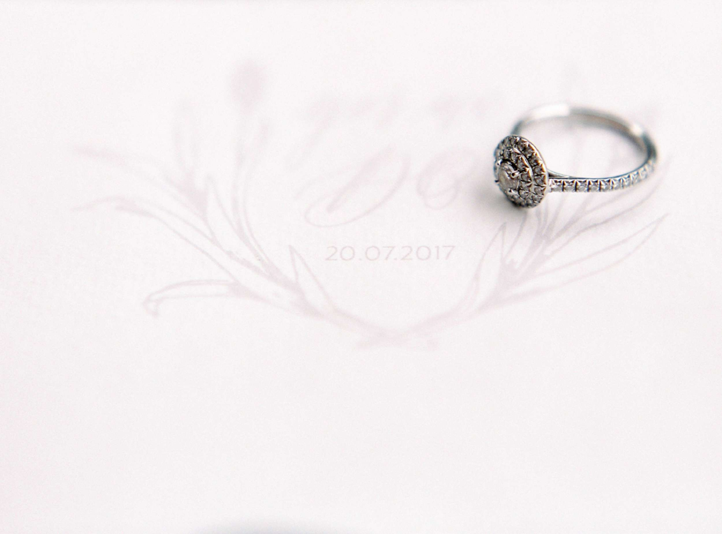 calligraphy monogram with engagement ring diamond