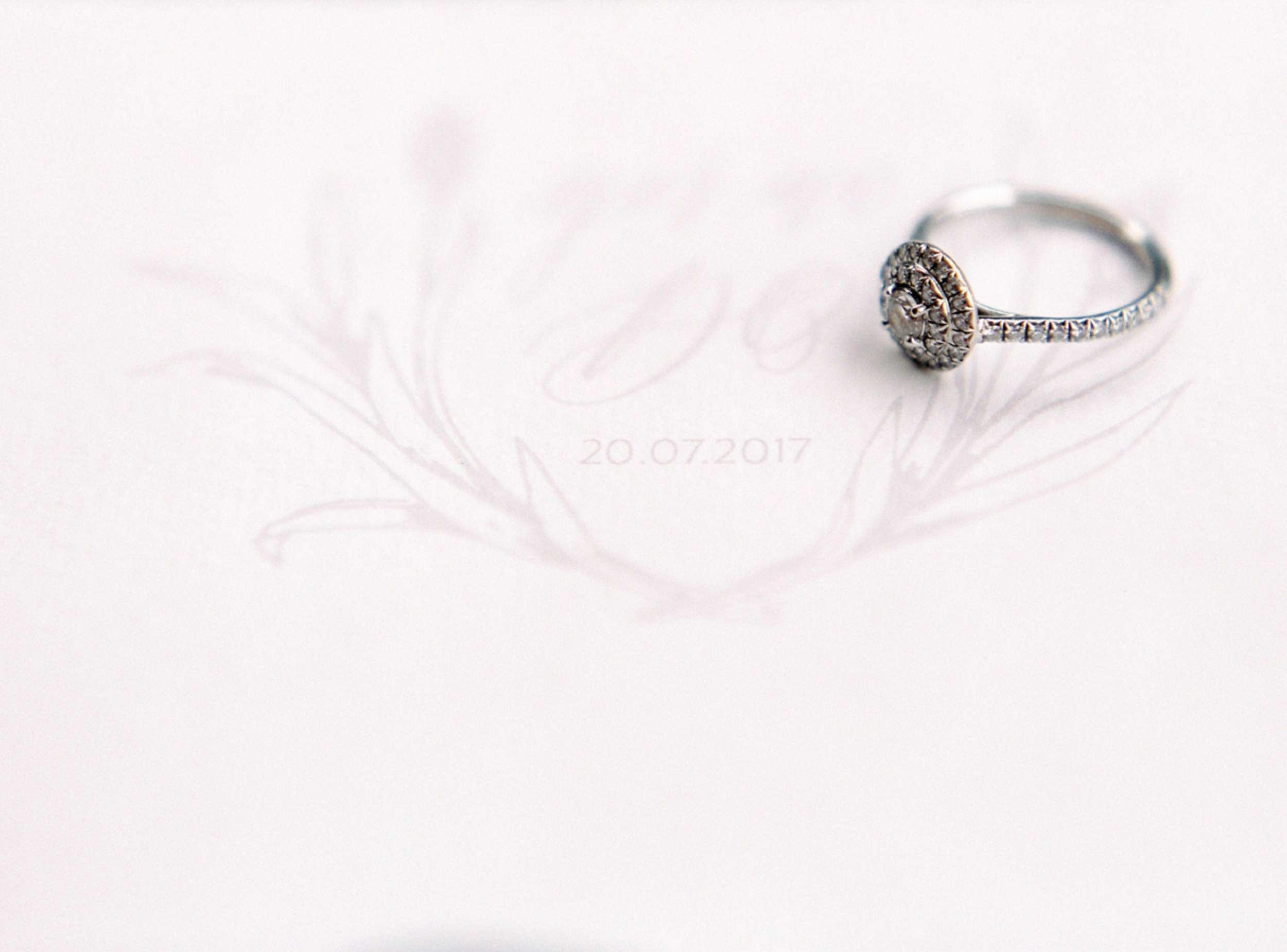calligraphy monogram with engagement ring diamond